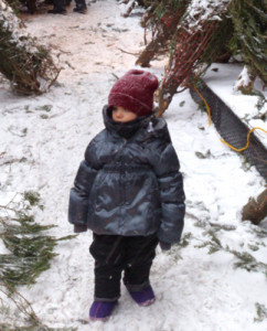 Tahra wearing her new purple Bogs during a snowstorm.